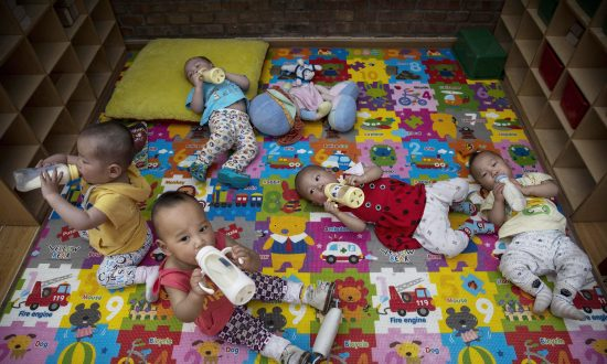 China's New Two-Child Policy: Throwing a Bone to the Public as the Economy Declines