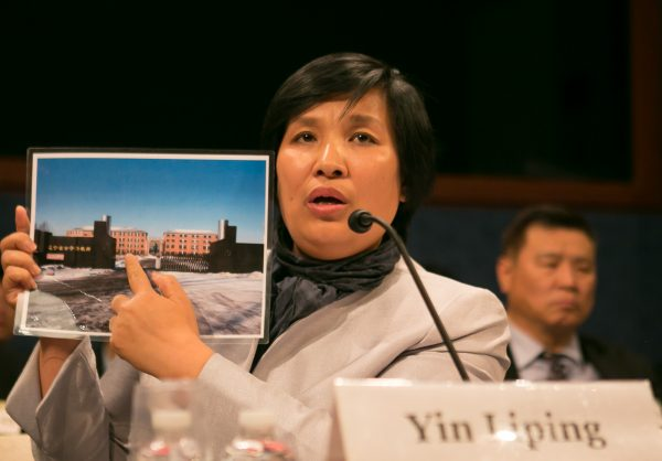 """Yin Liping testifies before the Congressional-Executive Commission on China, April 14, on """"China's Pervasive Use of Torture."""" Ms. Yin is a Falun Gong practitioner who survived torture, forced labor, and sexual violence in Masanjia and other forced labor camps in China. (Lisa Fan/Epoch Times)"""