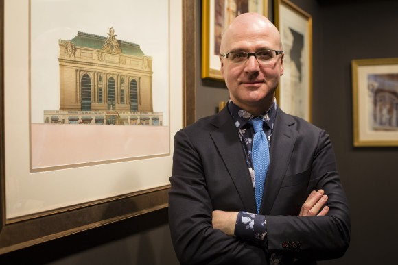 """Anton Glikin of Peter Pennoyer Architects at the """"Art of Architecture"""" exhibit at Eleventh Street Arts gallery in Queens, New York, on March 2, 2017. (Samira Bouaou/Epoch Times)"""