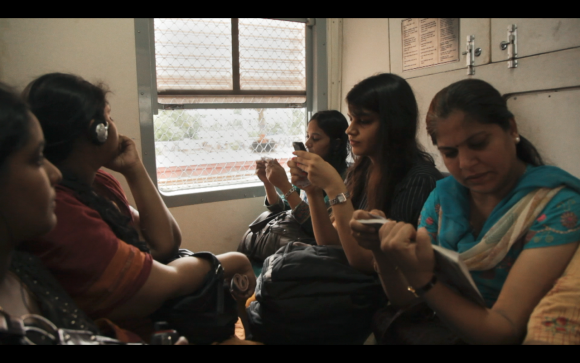 "Ritu (C) on a train in the documentary ""A Suitable Girl."""