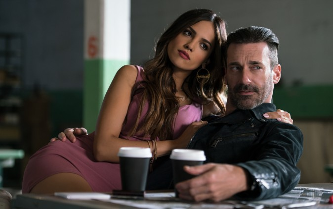 (L–R) Darling (Eiza Gonzalez) and Buddy (Jon Hamm) find out why Baby always listens to music in TriStar Pictures'