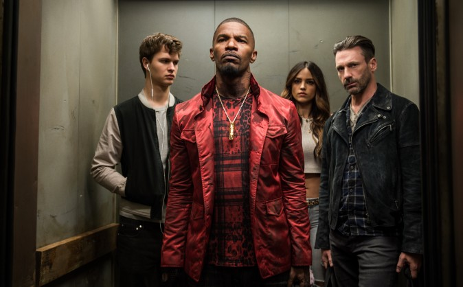 (L–R) Baby (Ansel Elgort), Bats (Jamie Foxx), Darling (EIiza Gonzalez) and Buddy (Jon Hamm) decide on doing the heist in TriStar Pictures'