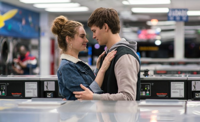 (L–R) Debora (Lily James) and Baby (Ansel Elgort) do Deborah's laundry in TriStar Pictures'