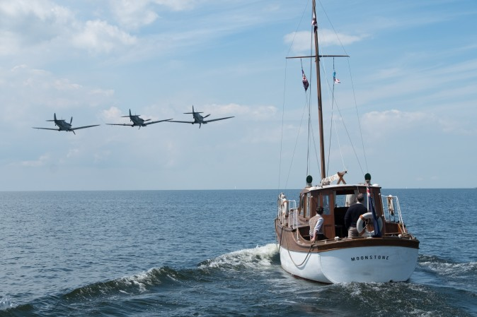 "British warplanes and civilian boats to the rescue in a scene from the Warner Bros. Pictures action thriller ""Dunkirk,"