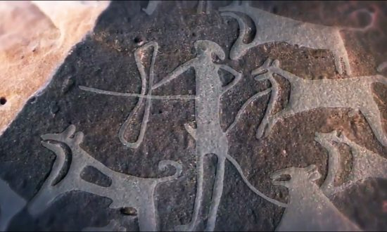 8,000-Year-Old Engraving Shows Dogs Were Helping Humans Hunt