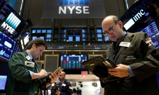 Dow Breaks Above 25,000 For First Time