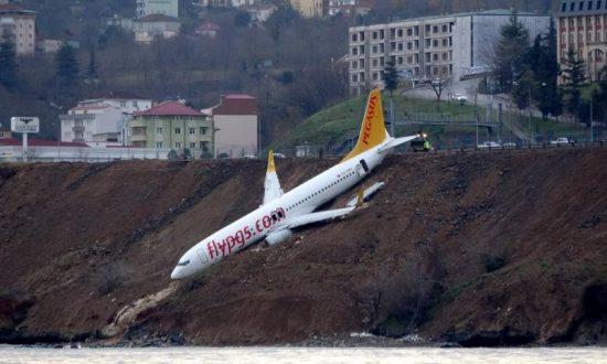 Plane Skids Off Turkish Runway and Hangs Off Slope Towards Sea