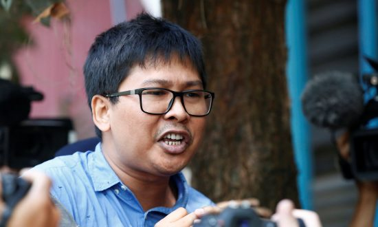 Burmese Prosecutor Seeks Official Secrets Act Charges Against Two Reuters Reporters