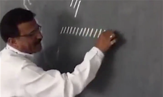 Teacher writes a bunch of lines on a chalkboard. When he connects them—I'm floored