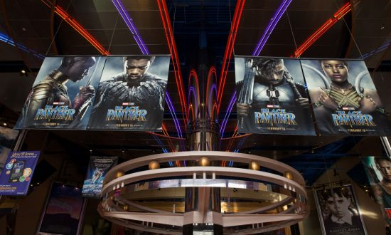 Teens Try Sneaking Into 'Black Panther' Screening Using Tall Coat Disguise