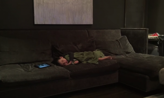 Boy asleep when parents play familiar song. It's so catchy—he starts doing weird thing in his sleep