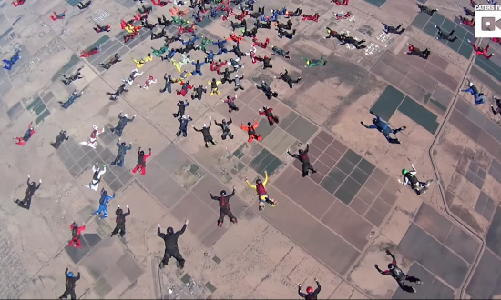 Over 200 skydivers jump at the same time—but wait till you see what they start doing in the air