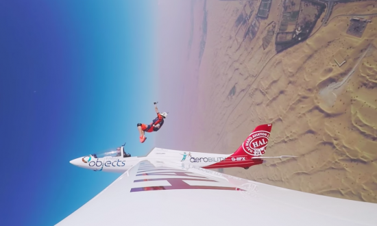 She's in the plane to skydive, but how she's ejected out of the plane—I had to rewind it