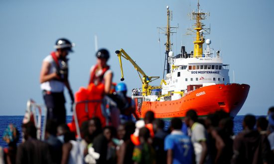 Activists Protest as Italy Prepares to Ship Migrants to Spain